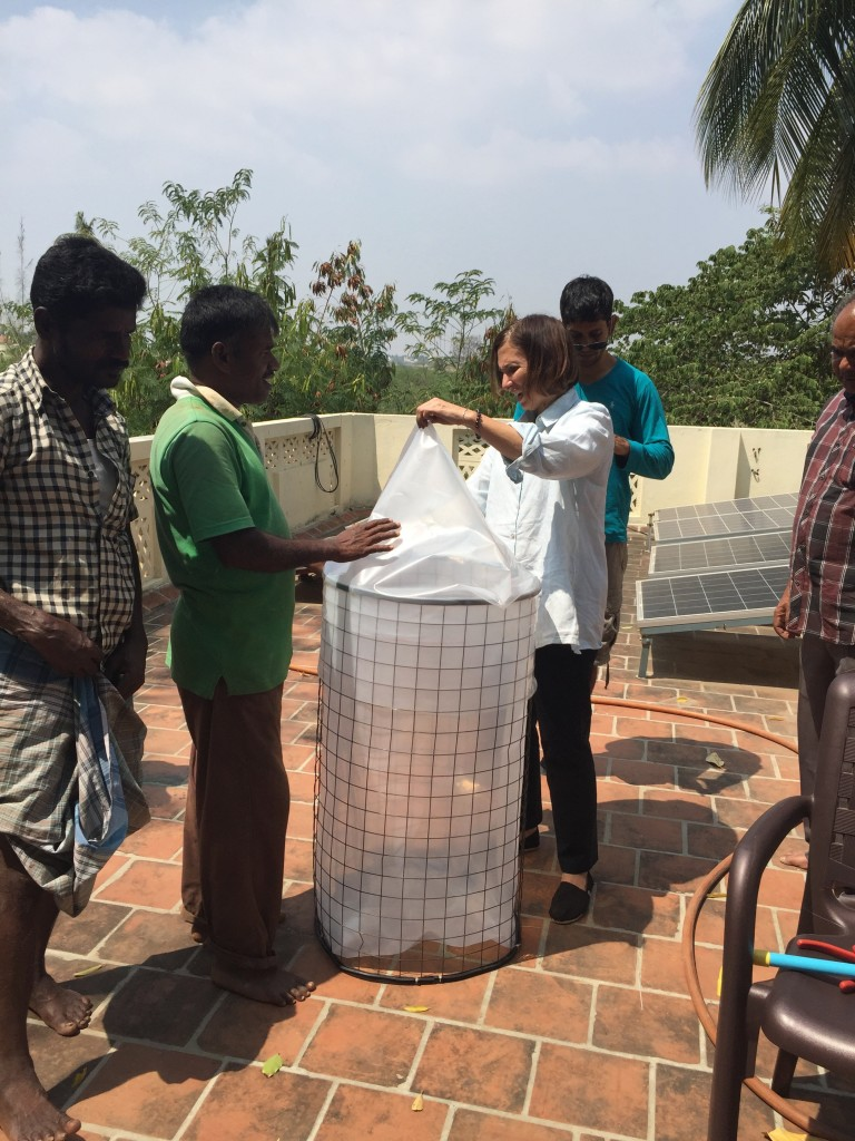 Bonnie showing the Madurai Antenna team how the caps of the tanks fit.